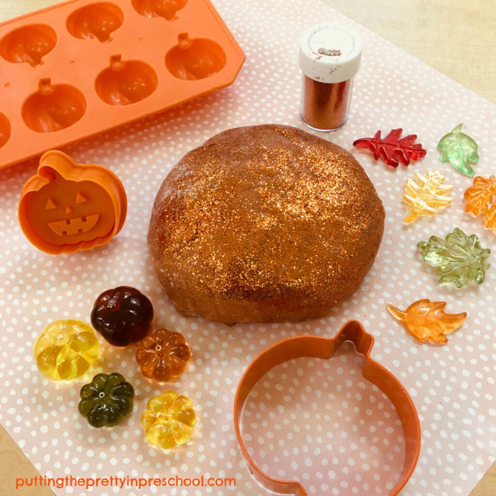 Pumpkin playdough with pumpkin-themed loose parts.