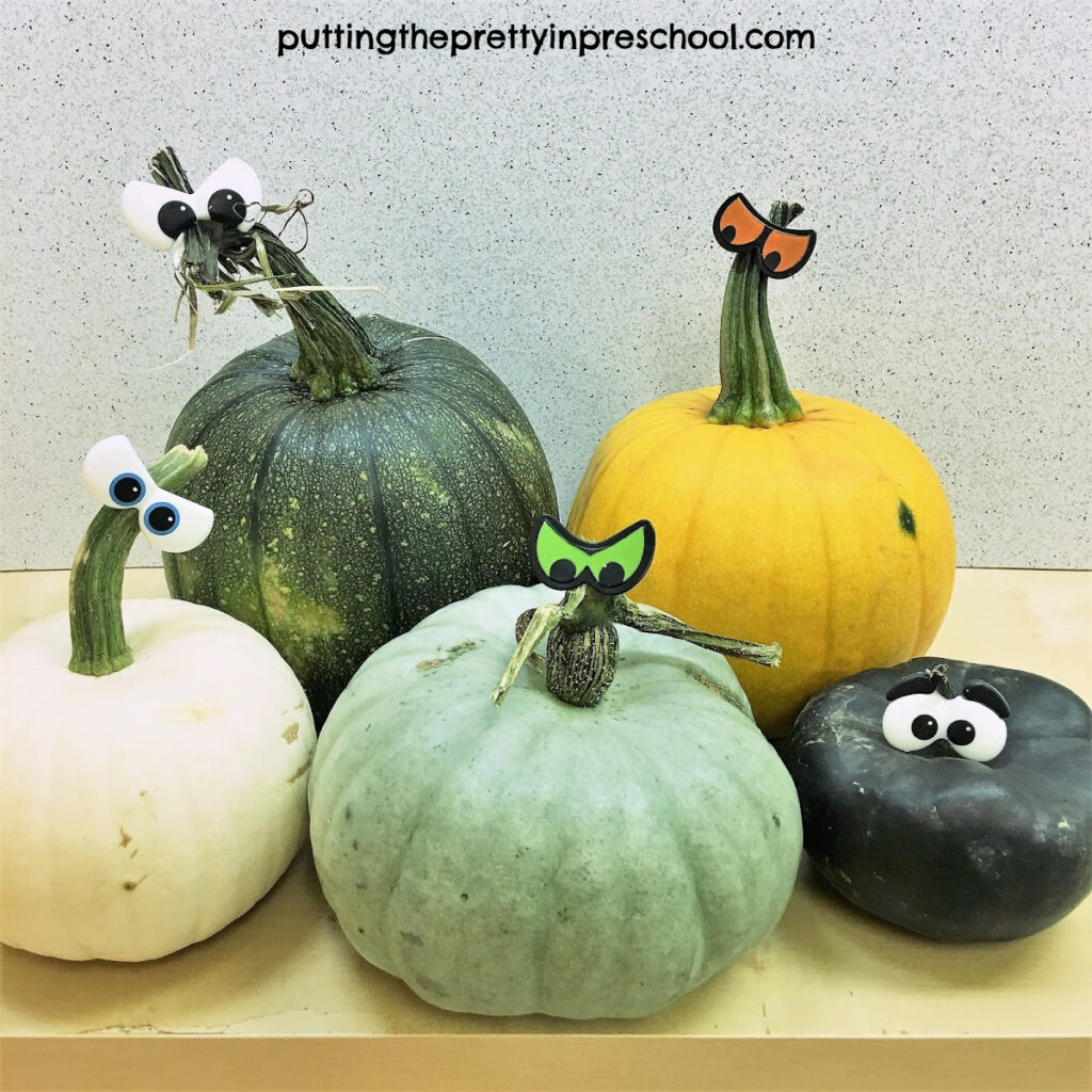 Pumpkins in mint, cream, black, yellow, and green colors.