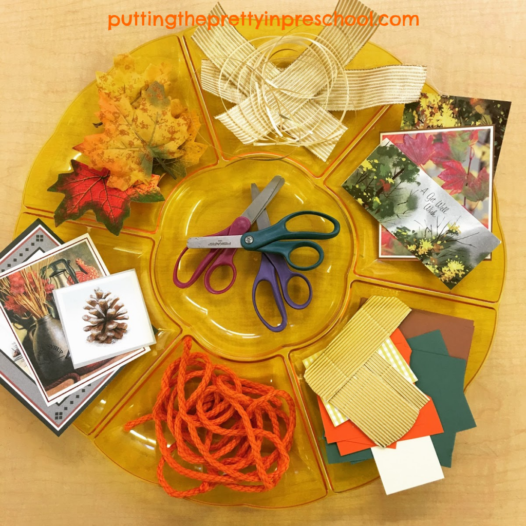 Scissor skills party tray with fall-themed craft supplies. Invitation to cut materials for collage.