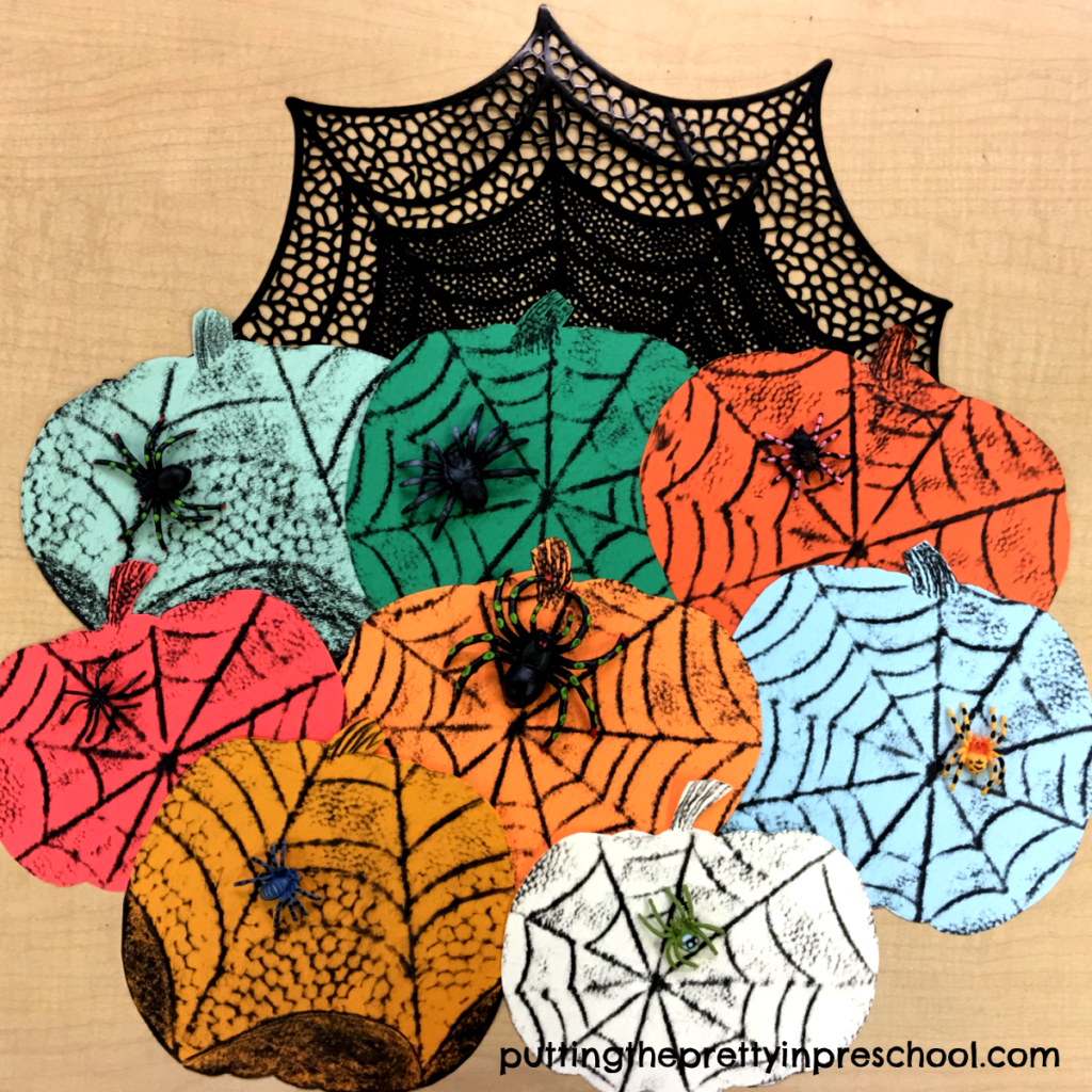 Crayon rubbings of spider webs on colored pumpkins. An all-ages art activity.