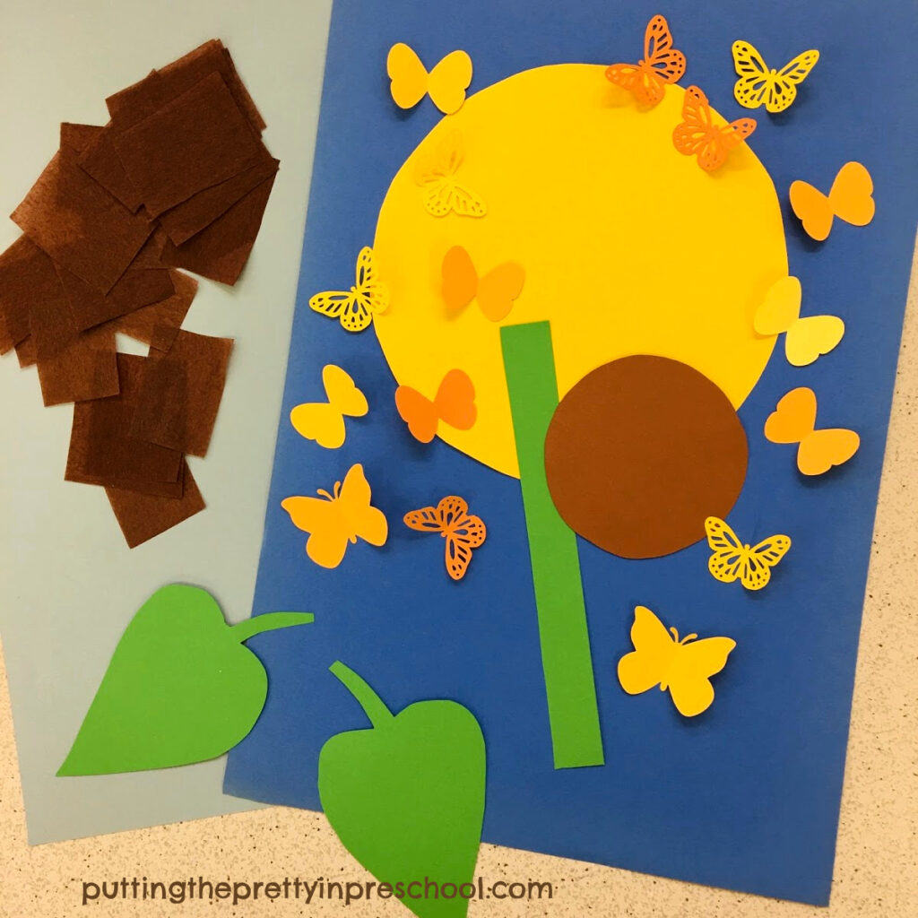 Paper supplies needed to make a butterfly-themed sunflower craft.