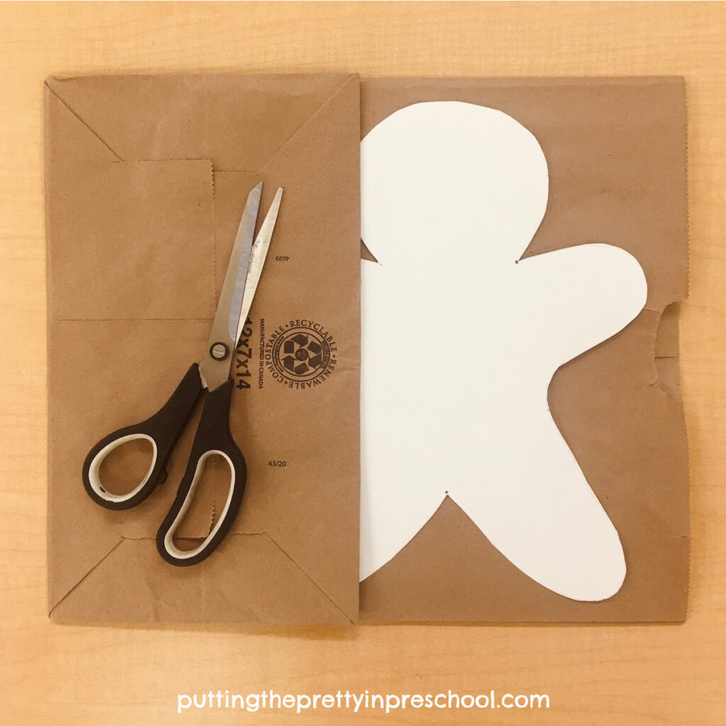 Paper bag ready to be cut into gingerbread men for a collage craft.