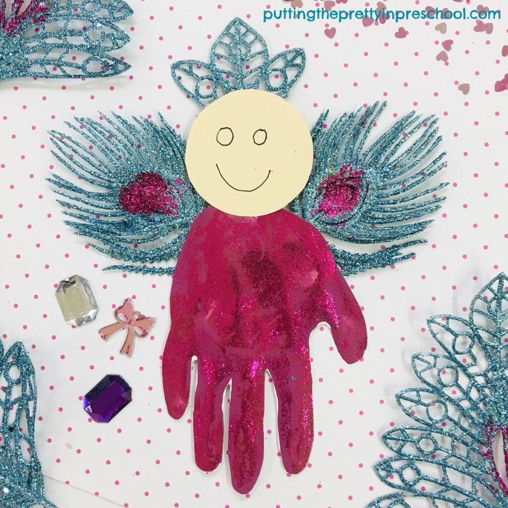 Turquoise and magenta handprint Christmas angel craft.