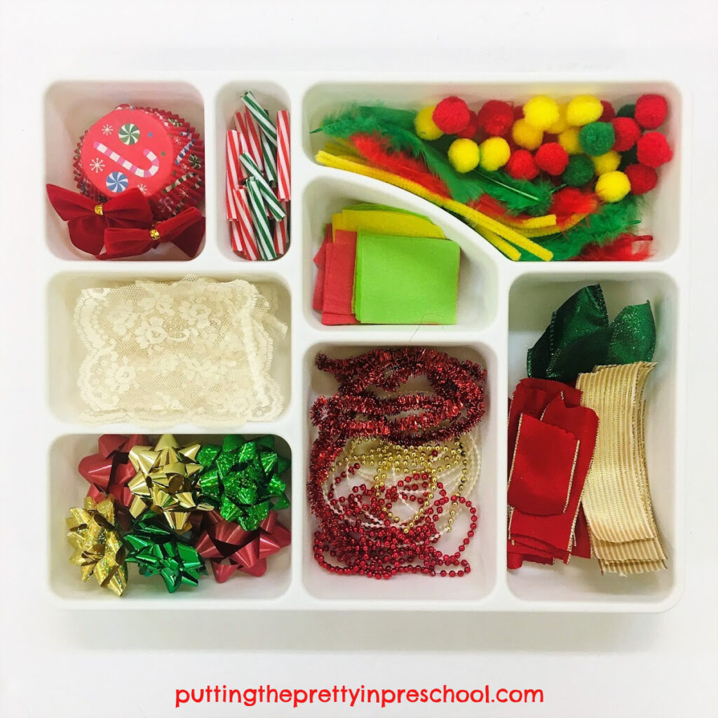 Compartment sorting tray with Christmas-themed craft supplies.