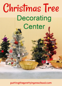 This festive Christmas tree decorating center for early learners features mini trees and child-friendly, nonbreakable decorations.