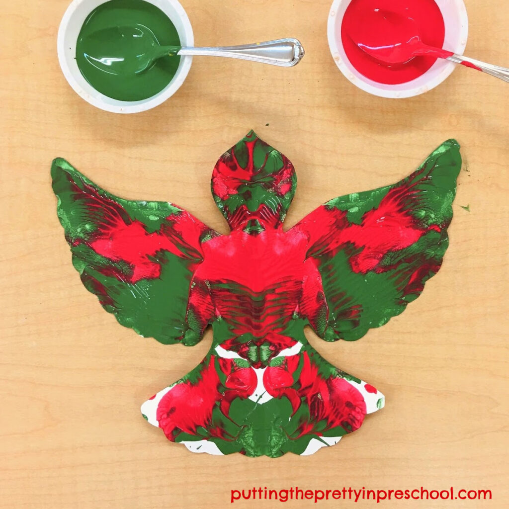 Squish painted dove art project in red and green colors.