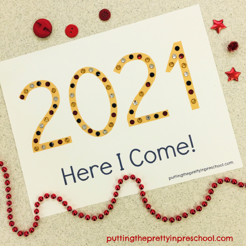 Adhesive gem decorated 2021 keepsake craft.