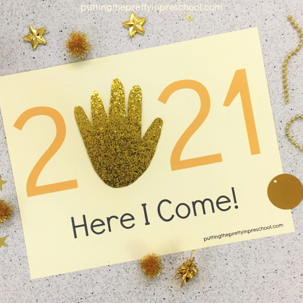 A gold glitter traced hand completes this 2021 keepsake craft.
