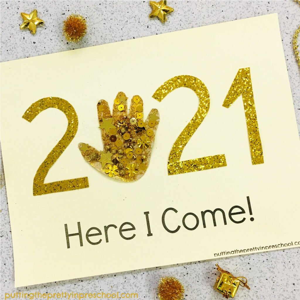 Gold-themed traced hand 2021 keepsake craft.