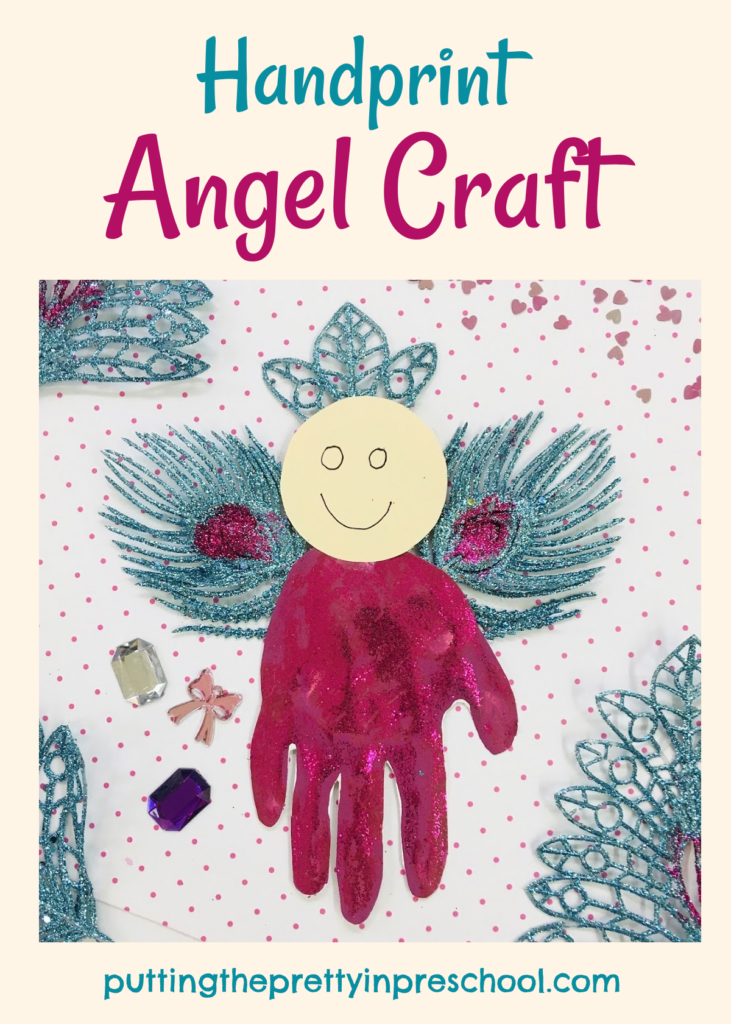 Handprint angel craft in magenta and turquoise colors.
