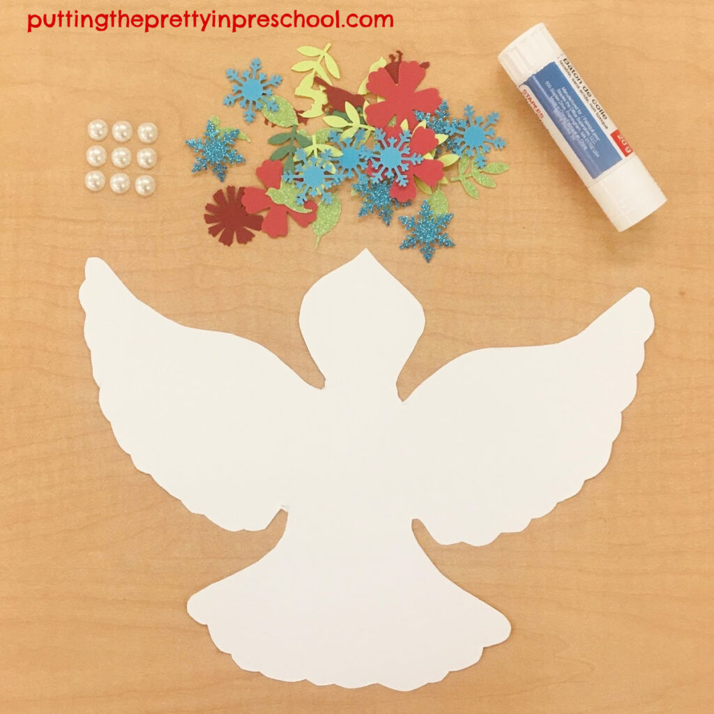 Set up with adhesive pearls and snowflake, leaf, flower, and bird paper shapes to glue onto a paper dove.