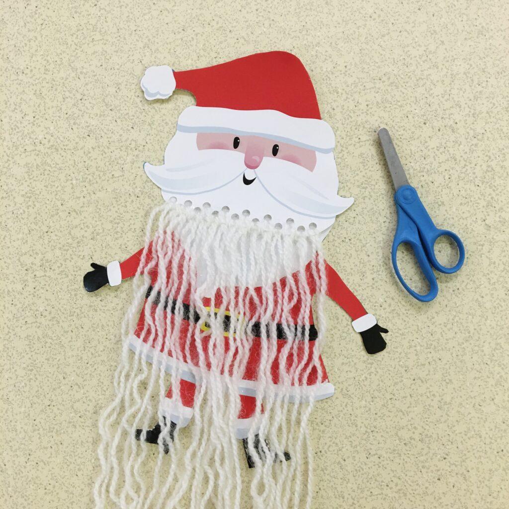 Invitation to trim gift bag Santa's beard.
