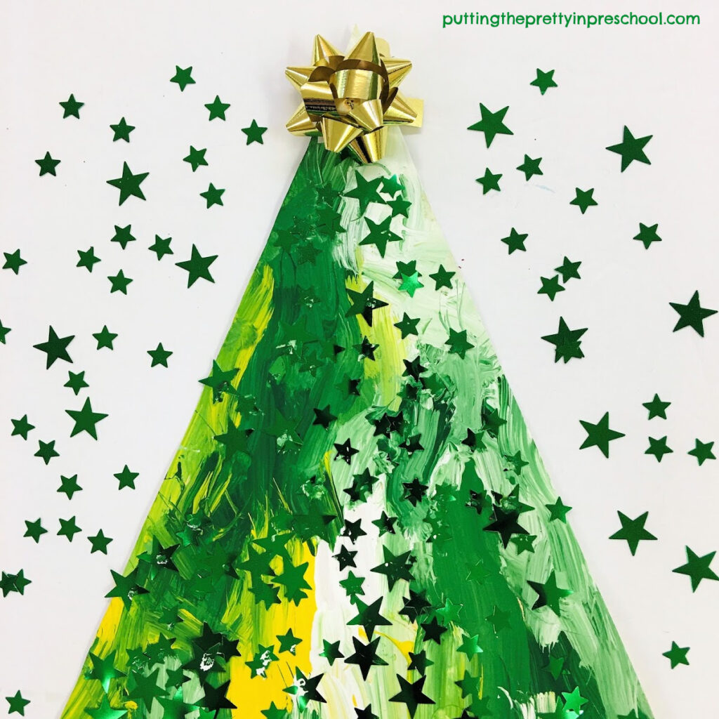 A Christmas gift bow is the topper for this painted Christmas tree craft.