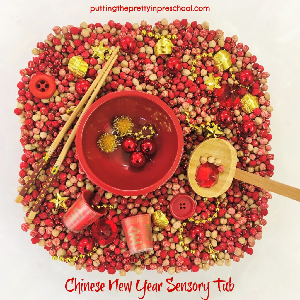 Dyed chickpeas in a tulip-shaped punch bowl with red and gold accessories.