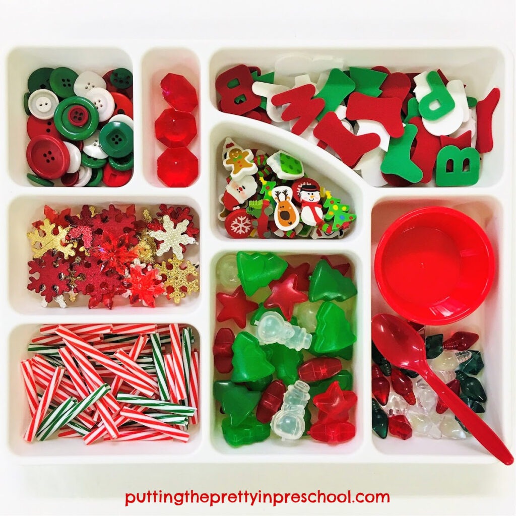 Christmas-themed loose parts tray for sensory play.
