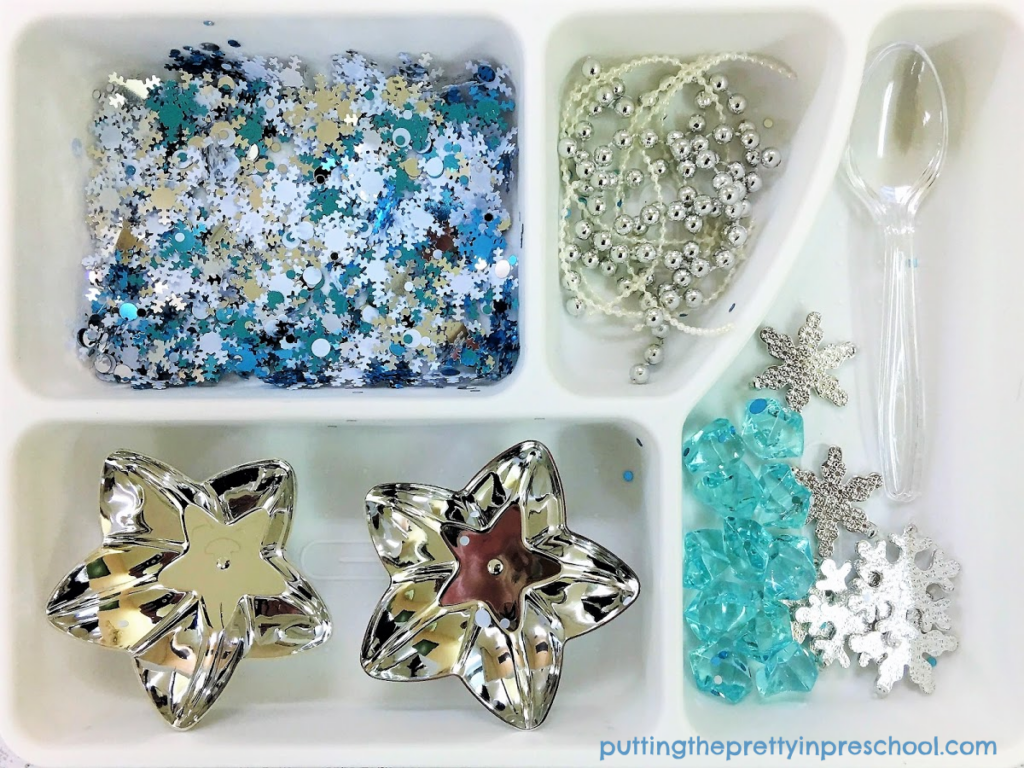 Winter sensory tray loose parts.
