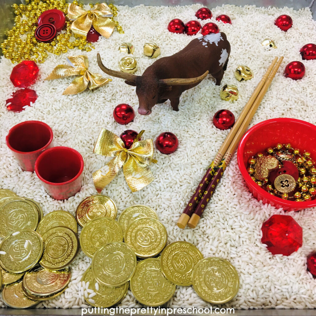 Year of the Ox Chinese New Year rice tray featuring a bull figurine and red and gold loose parts.