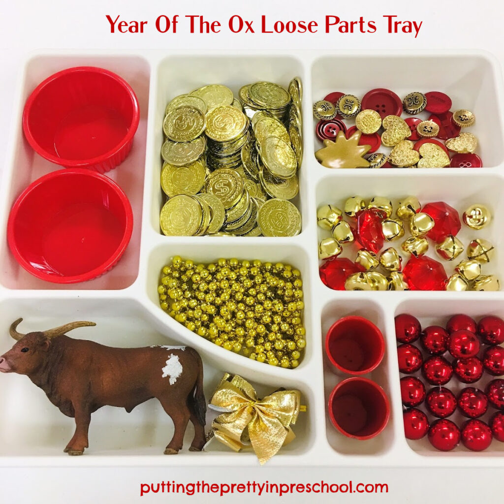 Year of the Ox tray featuring a bull figurine and red and gold loose parts.