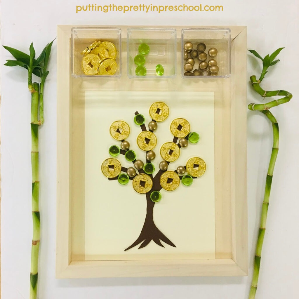 Invitation to decorate a Chinese money tree with gold coins and acrylic gems.