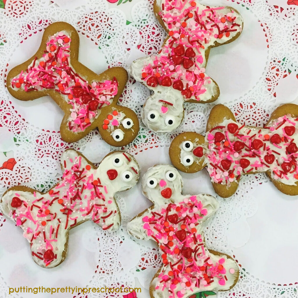 Gingerbread cookies decorated with hearts and candy sprinkles.