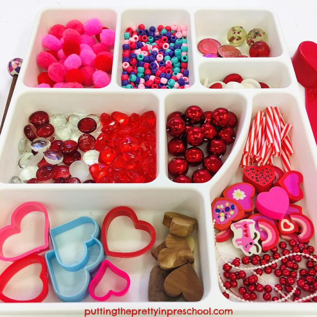 Loose parts to add to Valentine's Day containers to make shaker and drum musical instruments.
