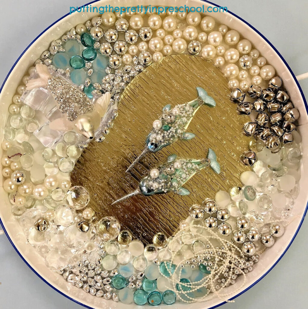 A glittery seal and embellished narwhals are the highlights of this luxurious sensory tray.