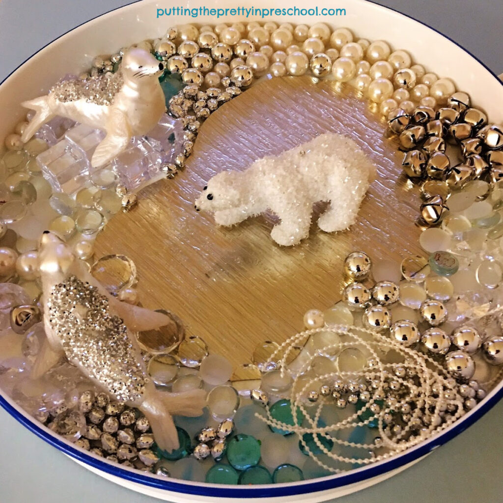 Polar bear and seal sensory tray with luxurious loose parts.