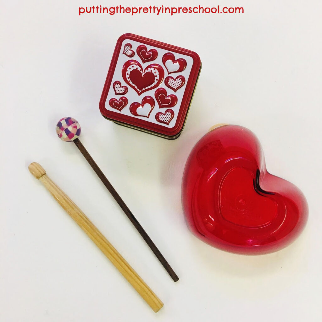 An overturned plastic heart-shaped bowl and small tin make excellent drums.