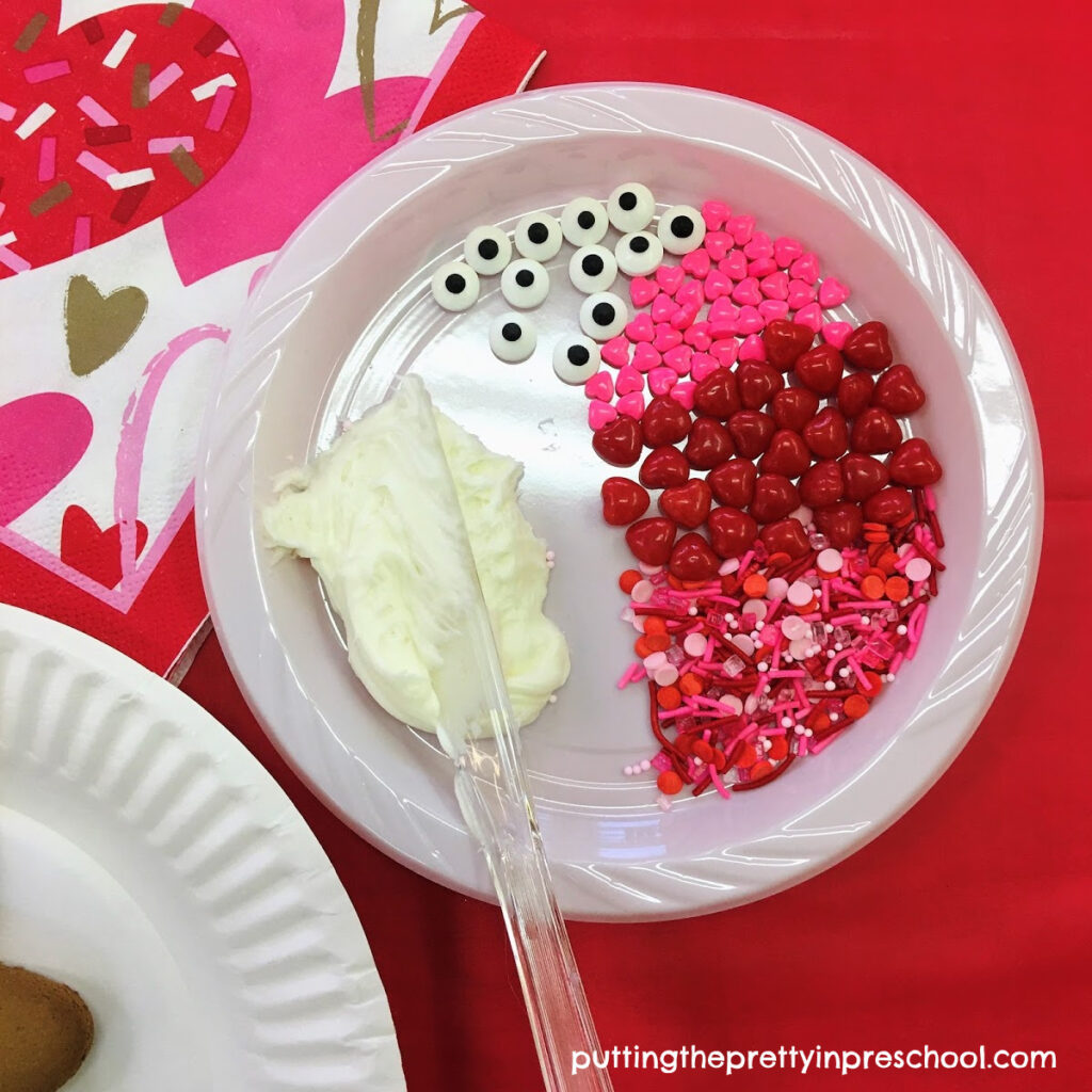 Heart and sprinkle decorations to decorate a Valentine's Day cookie.