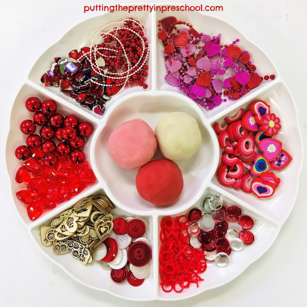 Valentine's Day-themed playdough and loose parts tray.