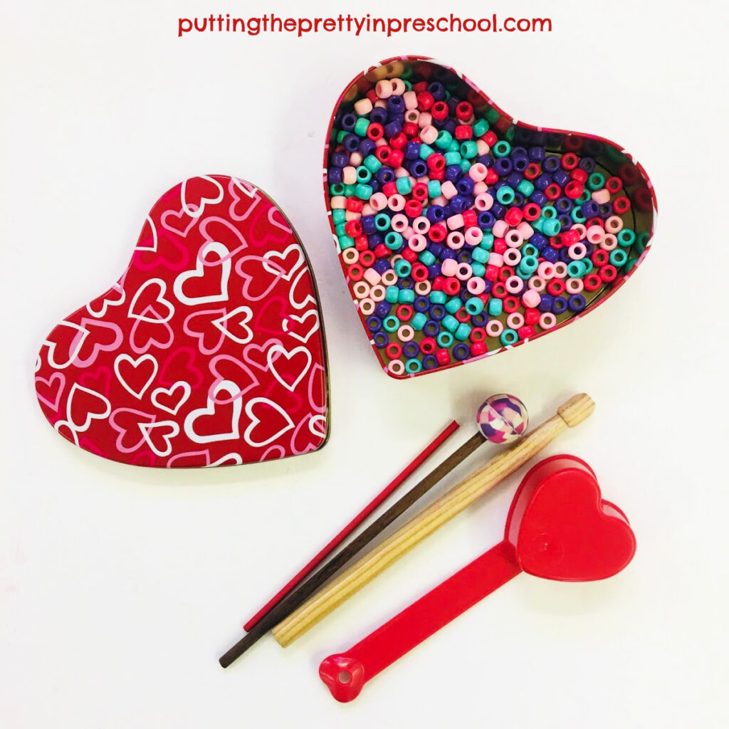 A heart-shaped tin with pony beads added makes an ocean drum.