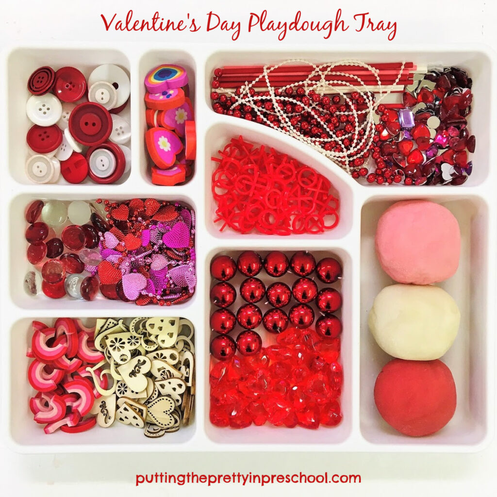 Valentine's Day playdough tray with loose parts and red, pink and white dough recipes.
