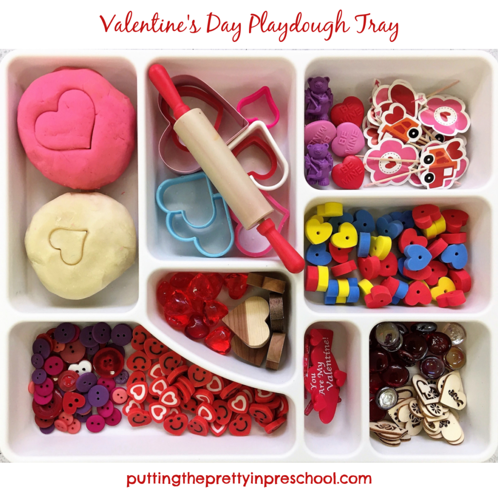 Valentine's Day playdough tray with loose parts and pink and white dough recipes.