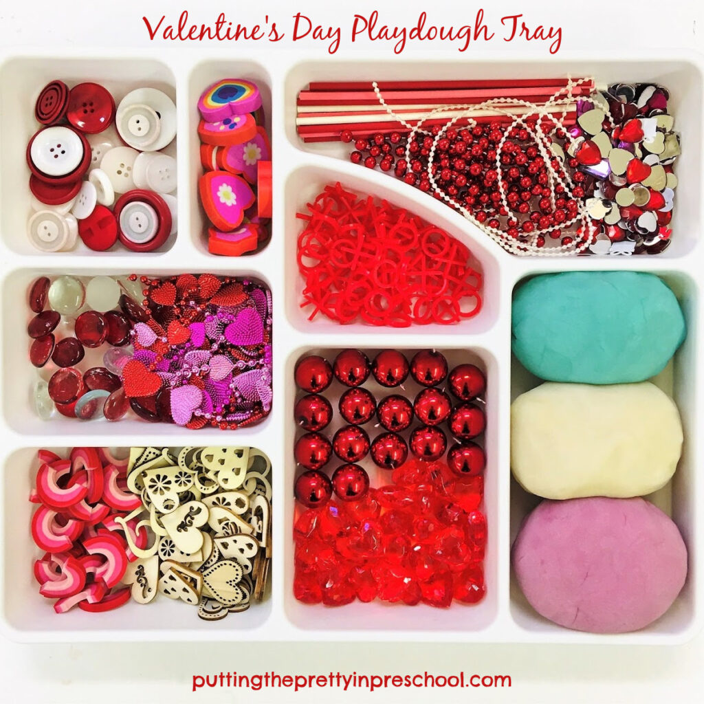 Valentine's Day playdough tray with loose parts and blueberry, white, and lilac dough recipes.