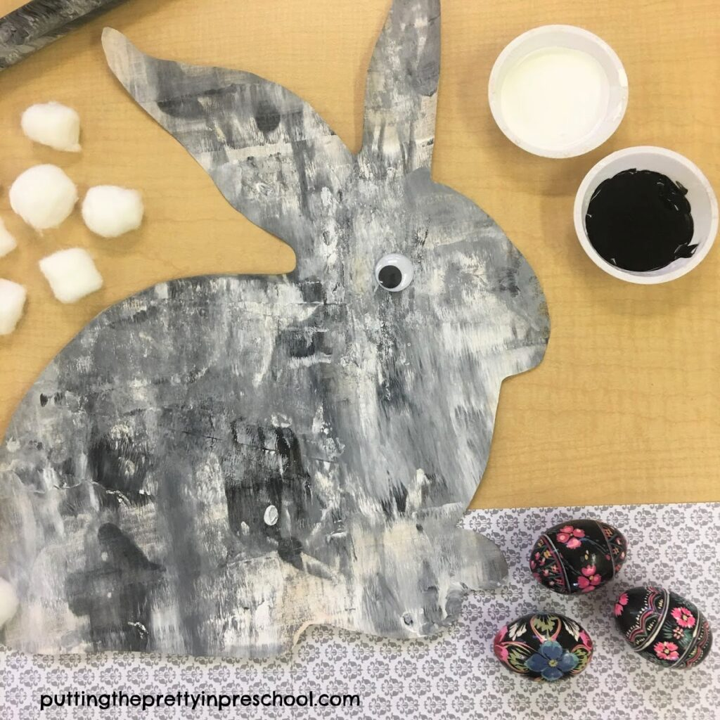 Black and white painted bunny using a rolling pin painting technique.
