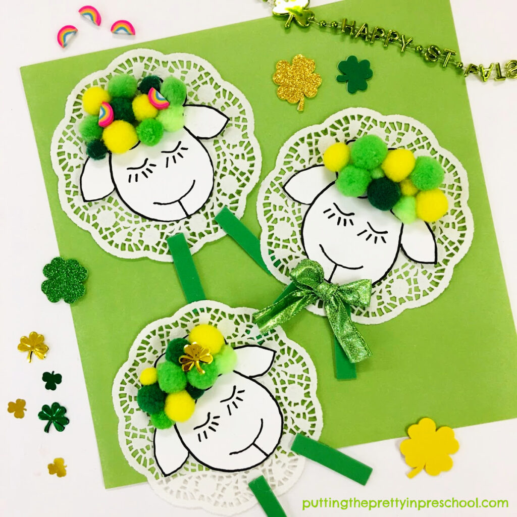 Cute doily and pompom sheep craft perfect for St. Patrick's Day or spring.