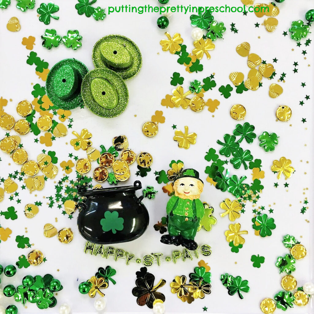 There is plenty of gold for the leprechaun to collect in this shamrock confetti-based St. Patrick's Day sensory tray.