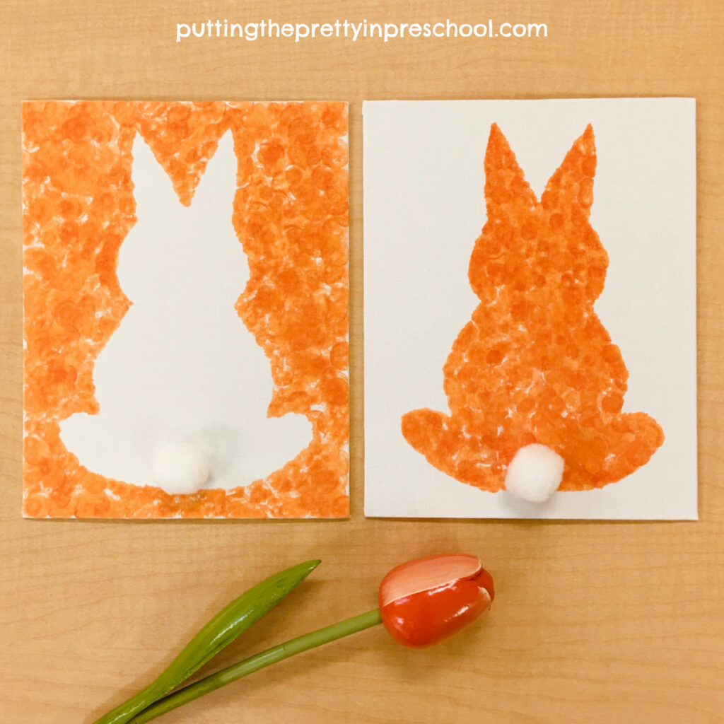 Silhouette bunny art made in two ways by dabbing spring-colored dot markers on a canvas. Free template included.