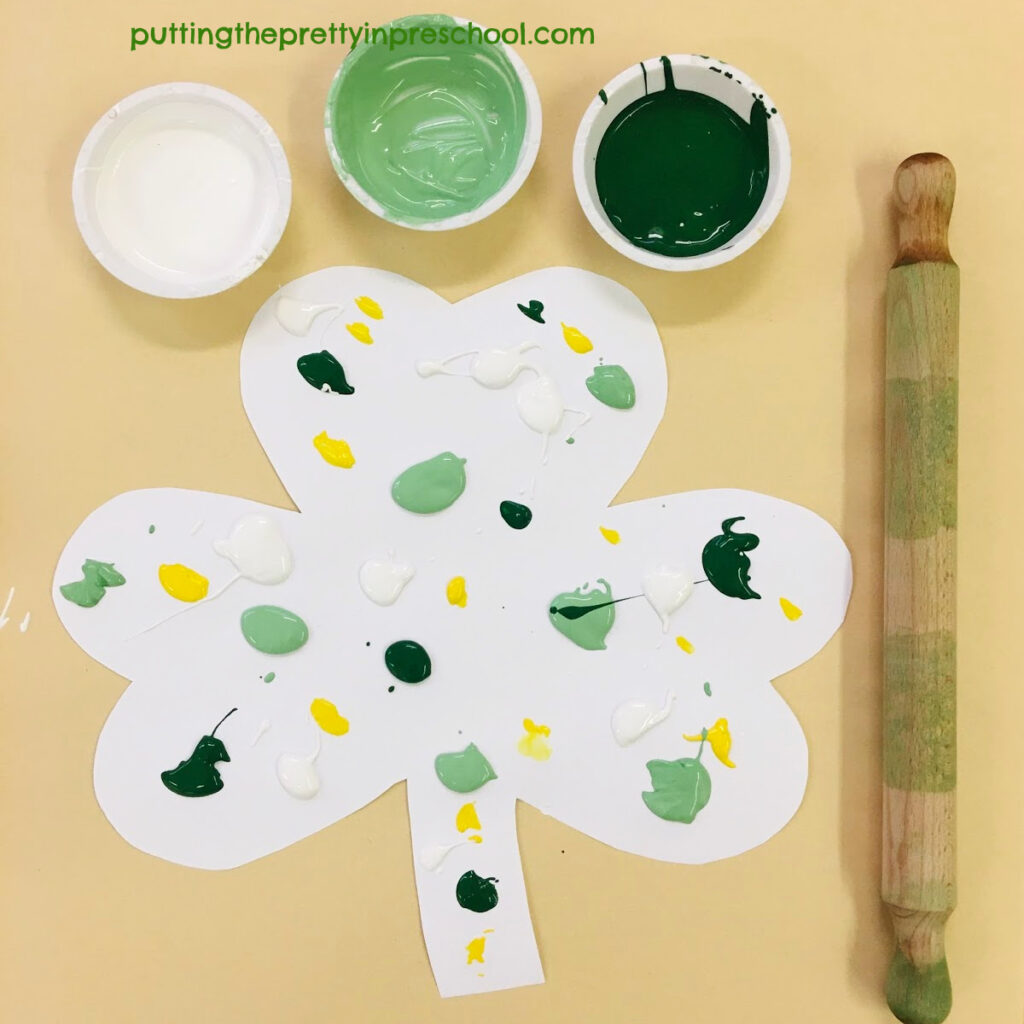 Invitation to use a rolling pin as a painting tool.