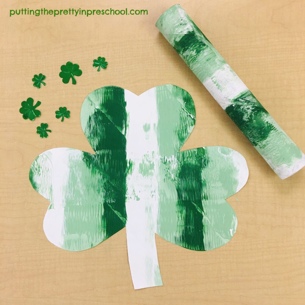 Paper towel roll painting on a shamrock.
