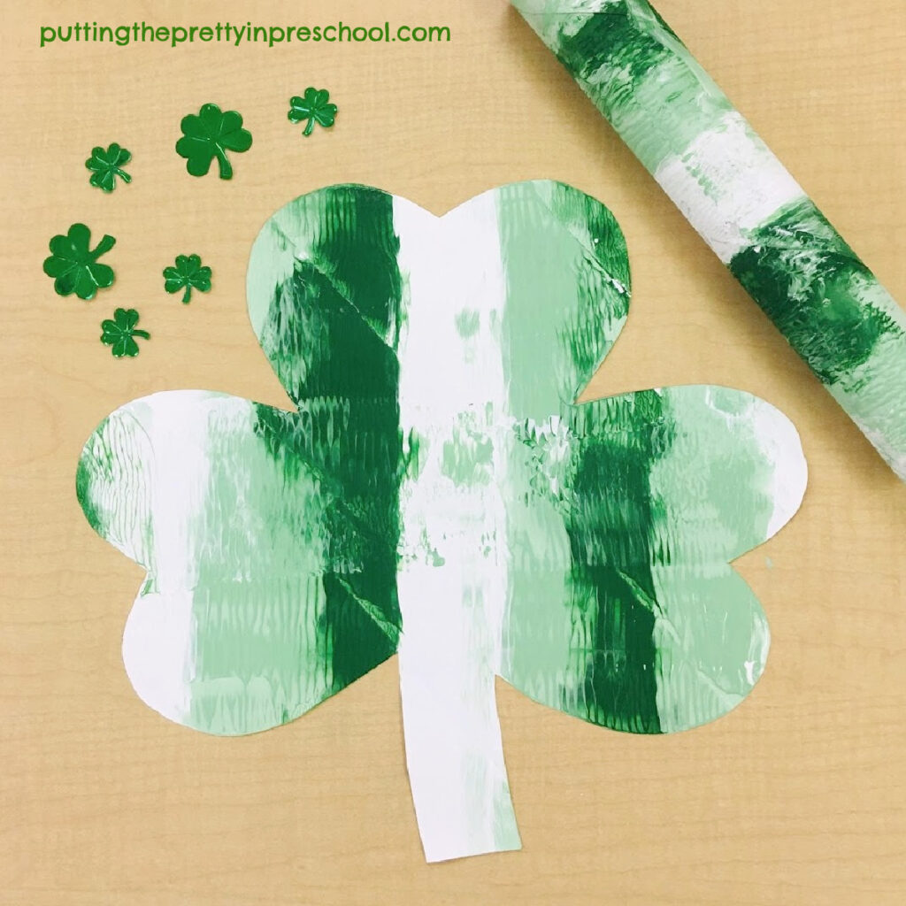 Striped shamrock paper towel roll art.