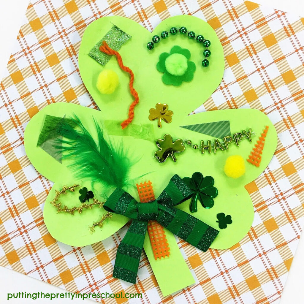 Shamrock collage with rust, yellow, and green textured craft supplies.
