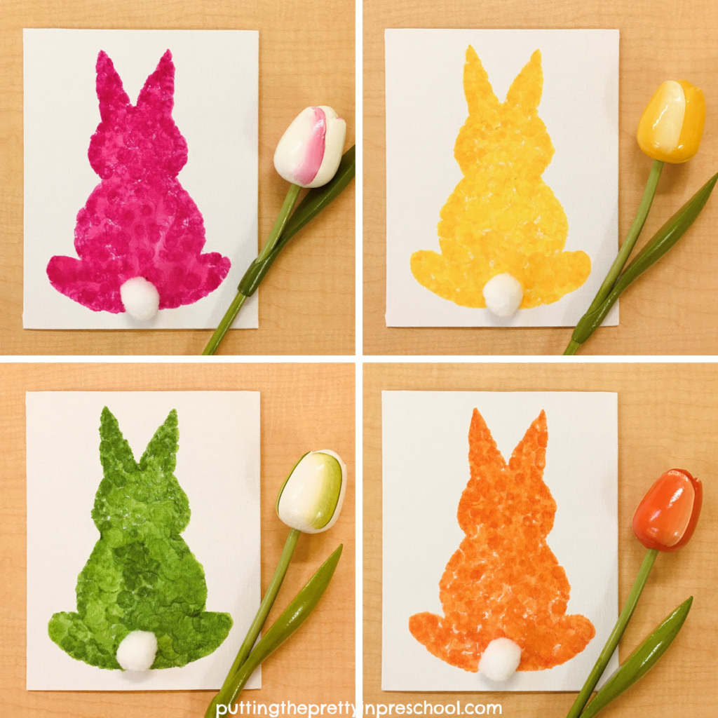 Adorable silhouette bunny art made by dabbing spring-colored dot markers on a canvas. Free template included. An art project for the whole family.