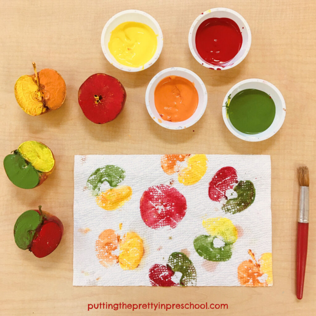 Make two-colored apple prints on absorbant paper towel.