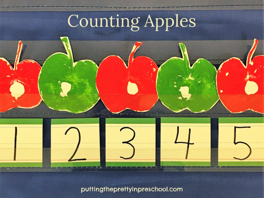 Cut apple paint prints used in fingerplays and counting activities.