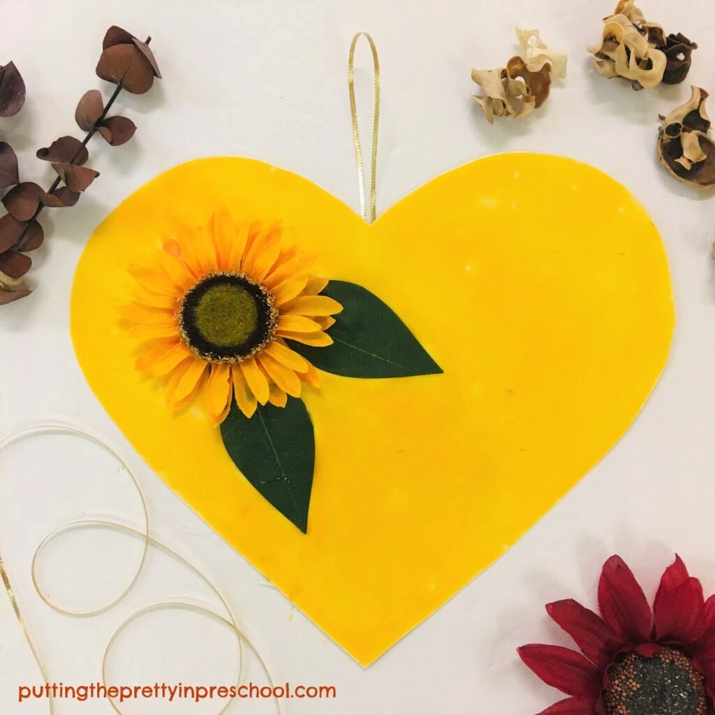 A bright and cheery sunflower heart craft for the whole family.